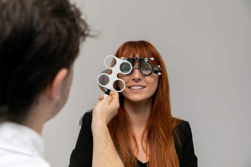 trial frame refraction by optometrist during the eye test